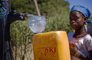 A girl collects water from a stand pipe in Costa del Sol near Maputo, Mozambique in April 2009. It was installed as part of the World Bank's Water and Sanitation Program. Image Source: Department of Foreign Affairs and Trade, Flickr, Creative Commons.