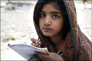 A girl studying in Pakistan's flooded area. Image Source: srizki, Flickr, creative commons