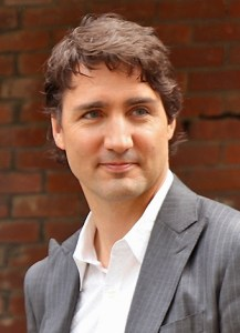 The Leader of the Liberal Party of Canada, Justin Trudeau, delivering a speech on a doorstep in Toronto's Little Italy