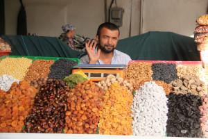Tajikistan fruit seller. Image Source: JM Fumeau, Flickr, Creative Commons