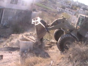 Israeli bulldozer Image Source: Palestine Solidarity Project, Flickr, Creative Commons