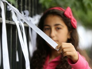 Trocaire, Flickr, Creative Commons Trocaire 561 copy Nocr Abu Shabab (11) from Palestine/Dublin looking at some of the 552 white ribbons hanging from the railings of Dublin's Merrion Square, One to commemorate each child who was killed during last Summers conflict in Gaza and Israel. The Ribbons were placed on the railings by Trocaire and Oxfam Ireland to mark the one year anniversary of the conflict beginning. The agencies warned that a lack of reconstruction and political progress in the year since the conflict has worsened the humanitarian crisis in Gaza, with approximately 100,000 people still homeless as a result of the conflict. Photo: Sam Boal/Photocall Ireland