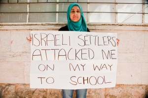 Image Source: Trocaire, Flickr, Creative Commons hebronsign_1 Sundus Al-Azzeh, 19, Hebron. Sundus has been beaten up on the way to school by Israeli settlers. Her family can no longer access their house from the main street. Photo: Garry Walsh