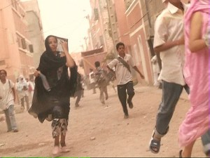Image Source: Western Sahara, Flickr, Creative Commons Running Demonstrators running away from a charge of occupation forces in Laayoune, the capital city of Western Sahara.