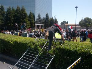 People were climbing over this barrier all afternoon.