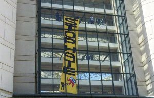 Protesters hung long banners in protest of CA GOP.