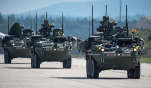 U.S. Army Stryker armored vehicles convoy (U.S. Air Force photo by Airman 1st Class Jordan Castelan/Released)
