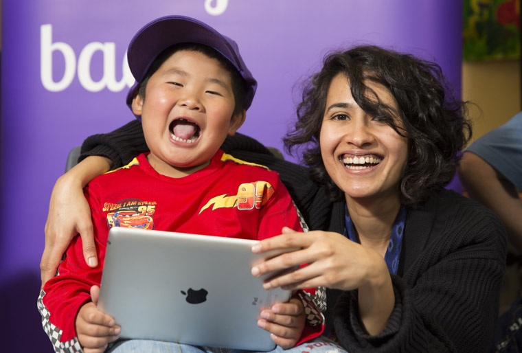 A child who benefitted from a crowd-funded project to buy iPads for children with disabilities