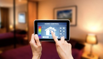 woman hand using smart home devie