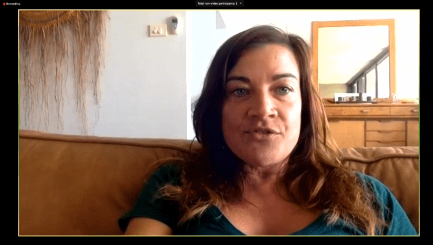 woman speaking into camera