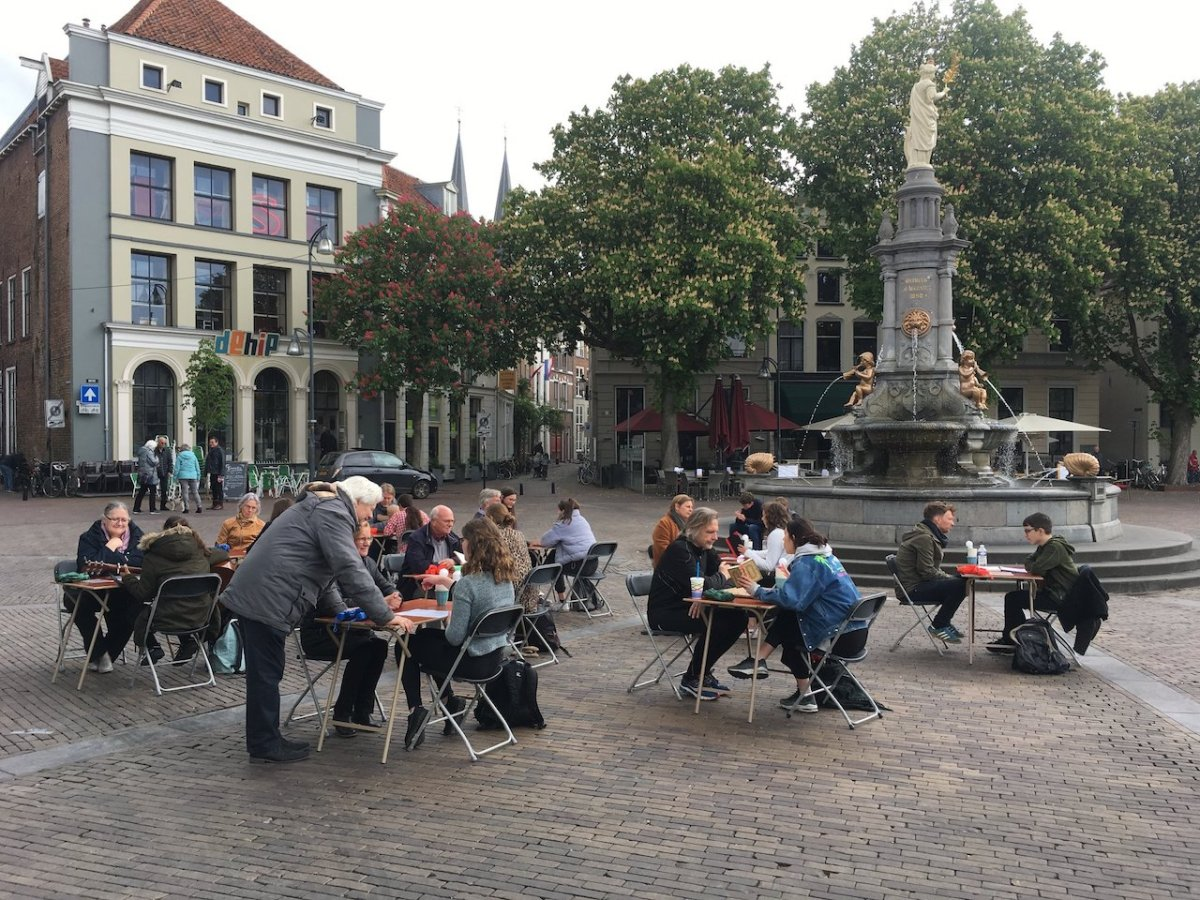 people sitting at tables outdoors