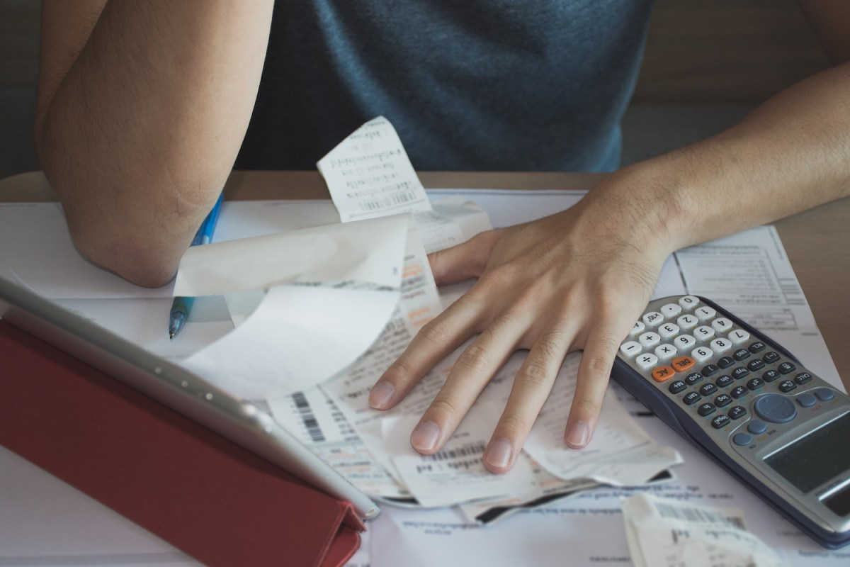 Stressed man with amount to be paid for electricity,financial problem
