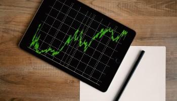 ipad on table green stock market