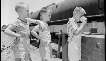 close up of children drinking water from water train
