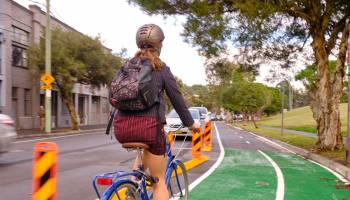 woman cycling on sydney roads