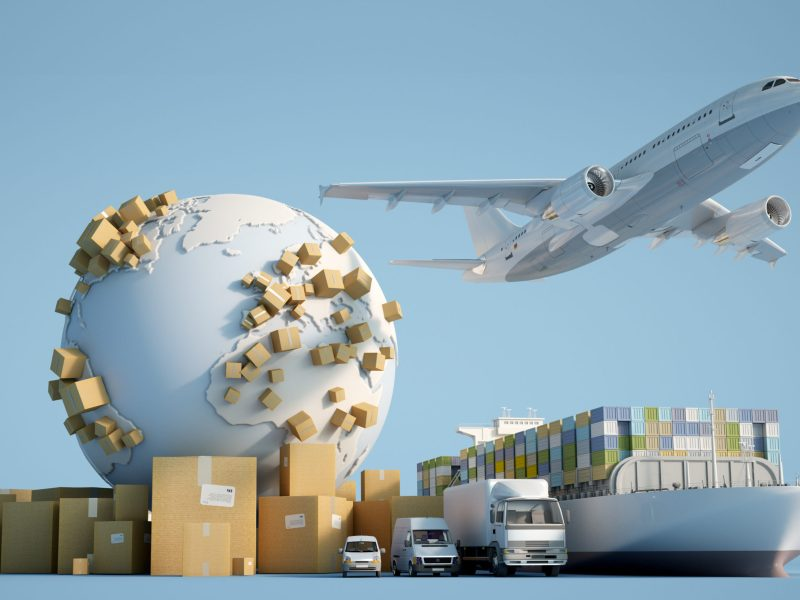 3D rendering of the Earth surrounded by cardboard boxes, a cargo container ship, a flying plane, a car, a van and a truck