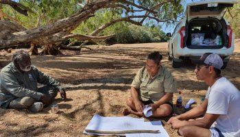 Mapoon verifiers Jason Jia and Sarah Barkley talking with Kowanyama senior elder John Clark