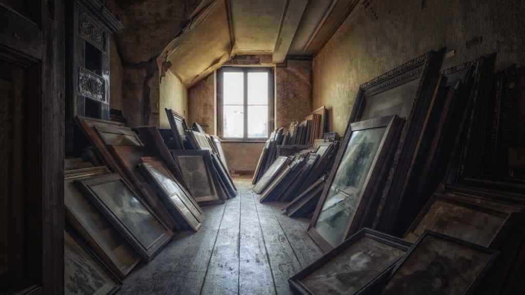 paintings and other artwork in an attic