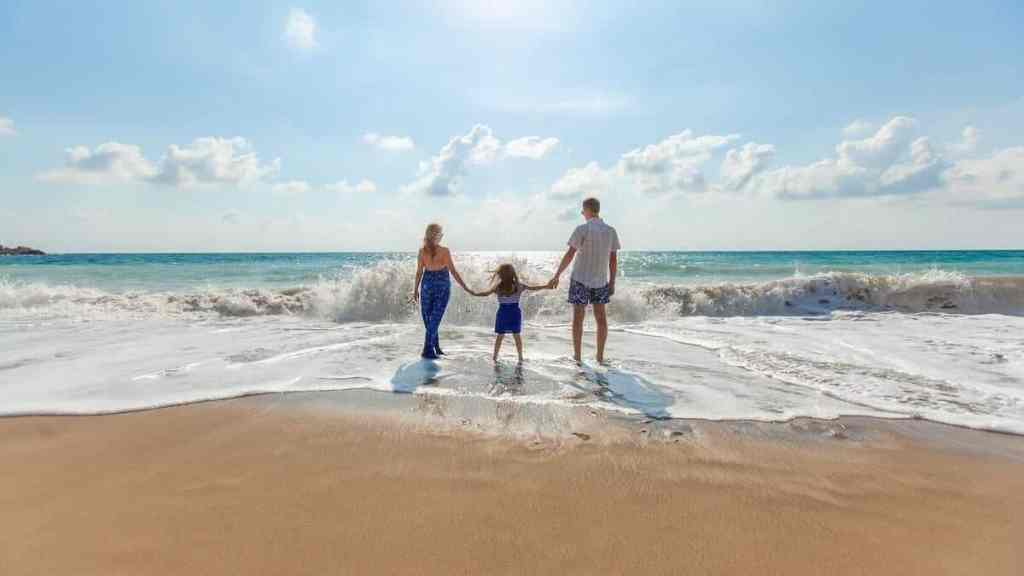 a family who took out a vacation loan spends time on a beach