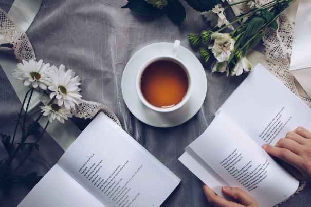 A picture of a book being read over coffee