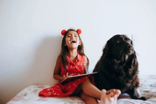 A happy child with a dog
