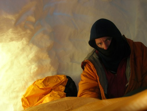 Mark contemplates his life in the snowcave at the top of the third icefield on Mount Hunter's Moonflower Buttress. May 2007 (Photo: Eamonn Walsh)