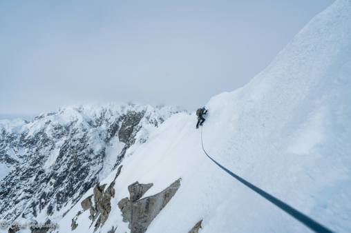 Roskelley carefully traverses the summit cornices of Idiot Peak on day five. The perfect weather they had enjoyed was breaking down rapidly. (Photo: Clint Helander)