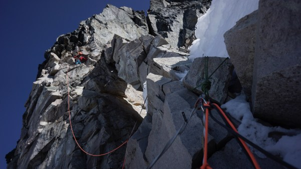Alaska - Chris Wright leading the crux loose rock band on Celeno Peak (Photo: Graham Zimmerman)