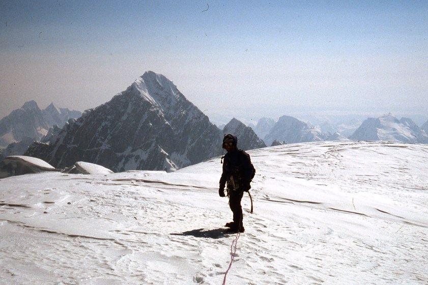Malcolm Bass on Kahiltna Queen/ Humble Peak, with Huntington in distance. Photo: Simon Yearsely
