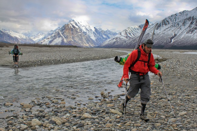 Noah squelches across a braid of the Big River on the trek towards home.