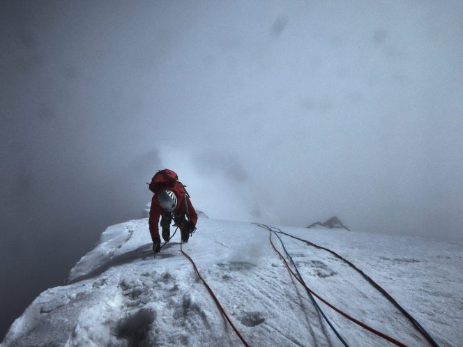 Paul Figg making the last few moves to the summit of Janhukot. Photo: Malcolm Bass