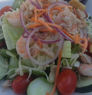 Healthy Salad topped with Shrimp