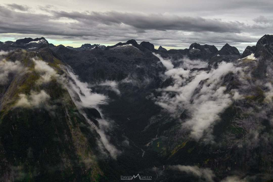 """The magnificent Milford Sound can't be missed while traveling to New Zealand. Why not go """"Over The Top"""" and see Milford Sound from a helicopter too? Read more on www.thefivefoottraveler.com"""