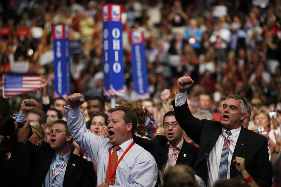 Delegates react as Republican presidential nominee Mitt Romney addresses delegates before speaking at the Republican National Convention in Tampa, Fla., on Thursday, Aug. 30, 2012.  (AP Photo/Jae C. Hong)