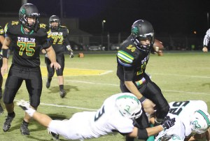 Dublin quarterback Brady Holleman passed for 140 yards and rushed for 106 Friday. || Photo by BRAD KEITH