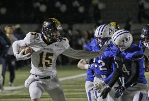 Josh Nowell uses a stiff arm after a catch in the first half.    Photo by RUSSELL HUFFMAN