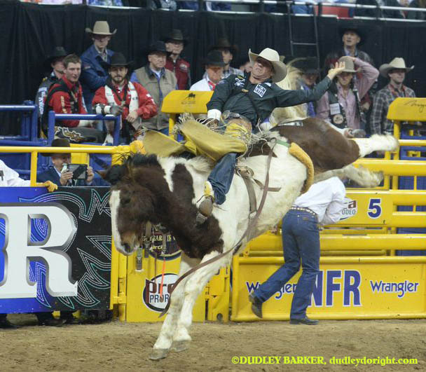 Four-time world champ and current world leader Bobby Mote is in first place in the average at the ongoing Reno Rodeo. Mote is shown competing in the 2014 National Finals Rodeo. || Photo courtesy DUDLEY BARKER/Dudleydoright.com