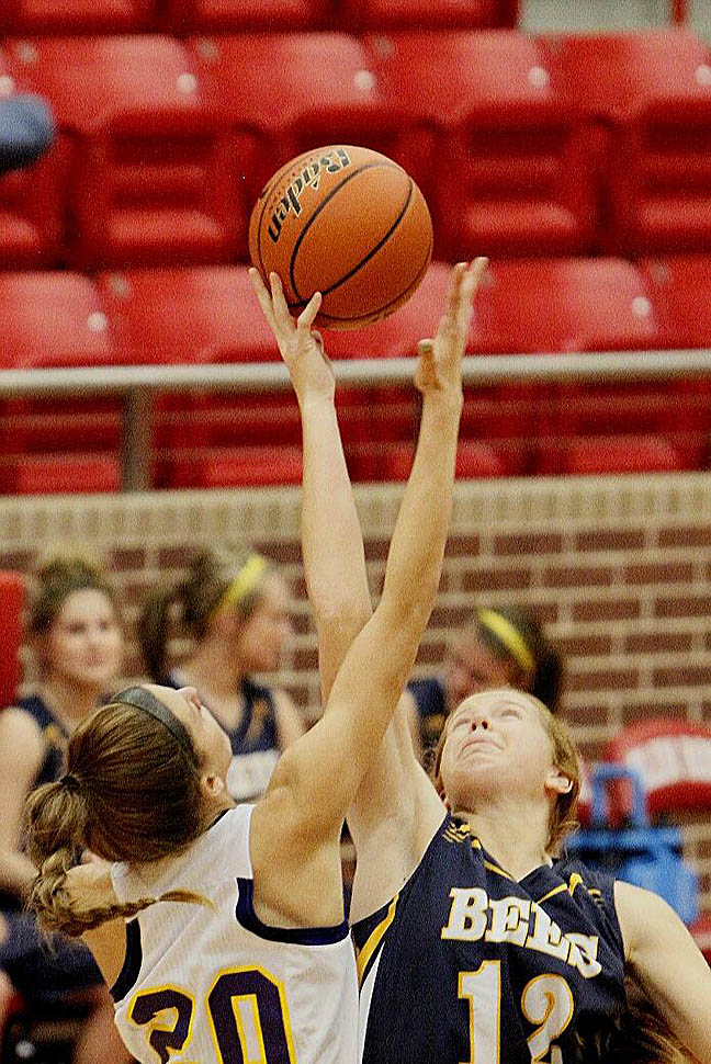 Lariat Larner wins the opening tipoff for Stephenville Saturday. || Photo by RUSSELL HUFFMAN
