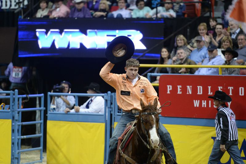 Marty Yates became the first competitor at the 2014 Wrangler National Finals Rodeo to win three go-rounds Tuesday night, when he shared top money in the round six tie-down roping in 6.9 seconds. || Photo by DUDLEY BARKER, dudleydoright.com