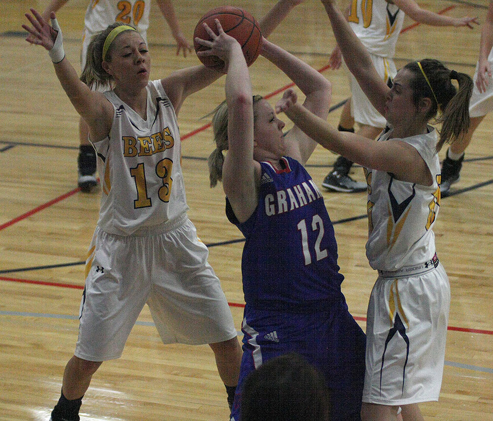 PRESSURE  COOKER: Bayleigh Chaviers, left, and Cassidy Cline apply pressure during the first half of Stephenville's 63-30 rout of Graham at Gandy Gym Friday evening. || Photo by BRAD KEITH