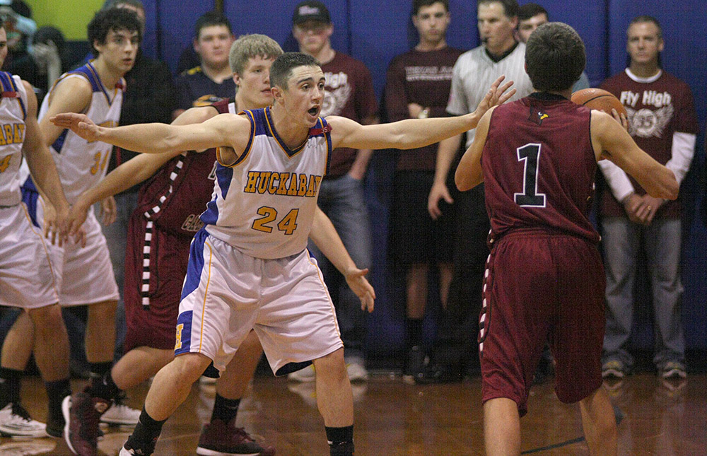 Huckabay's Ky Bray gets defensive in front of Lingleville's Tim Griffin, 1.    Photo by BRAD KEITH