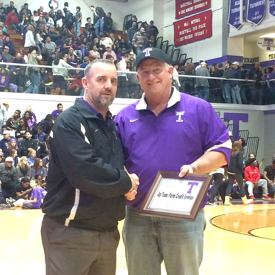 Joe Bob Huddleston represents Ag Texas Farm Credit Services, which was awarded a plaque from Tarleton assistant athletic director Troy Jones, left, for being a corporate sponsor of a recent basketball doubleheader at Wisdom Gym.    Photo by BRAD KEITH