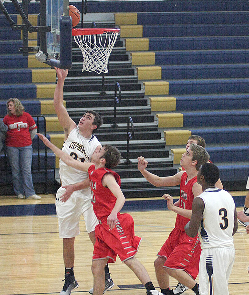 Zoey Kendall scores on a put back in the paint for Stephenville. He had 19 in a narrow loss to Lorena at Gandy Gym Saturday. || Photo by BRAD KEITH