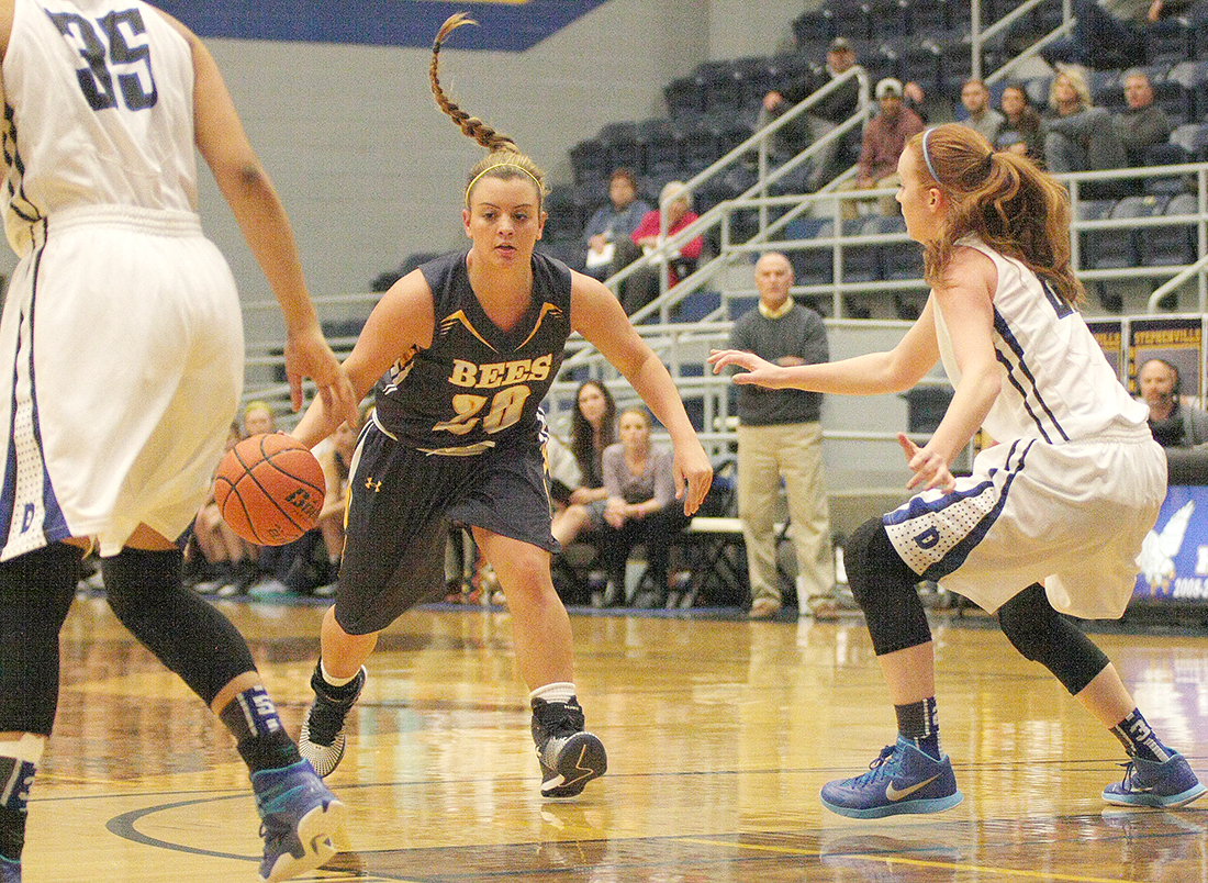 Stephenville senior Lyndi Graham had the pony tail flying while driving through the Decatur defense Thursday evening. || Photo by BRAD KEITH