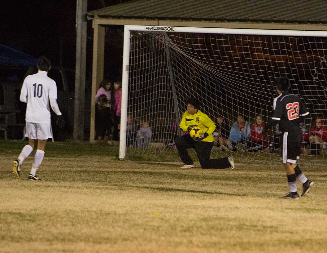 Keeper Noah Alexander covers one up in another shutout win for the Yellow Jackets. || Photo by RUSSELL HUFFMAN
