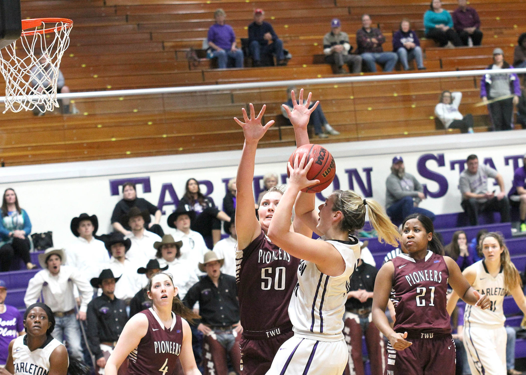 Raven McGrath hits a short jumper for two of her seven overtime points, helping Tarleton defeat Texas Woman's 82-76 Sunday at Wisdom Gym. || Photo by Dr. CHET MARTIN