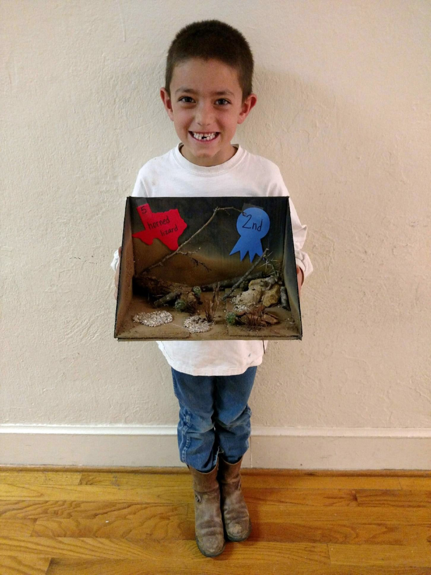 Dillan Soderlind earned second place with his Texas State Symbol project - horned lizard.