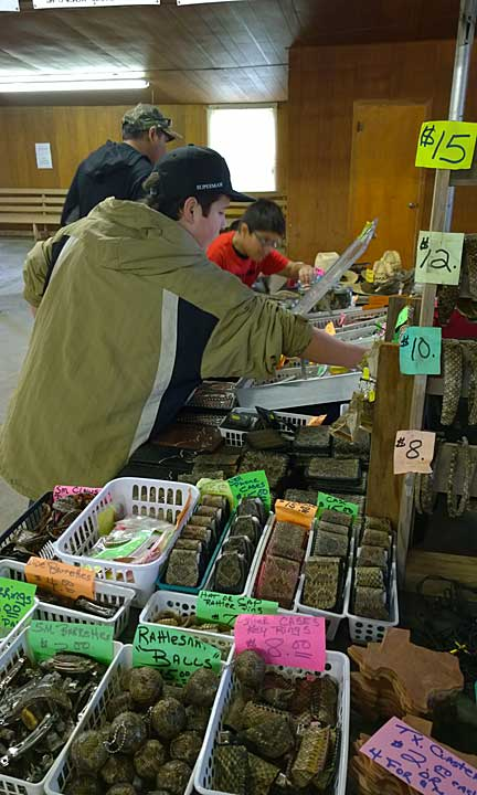 Shoppers check out the many items made from rattlesnakes.