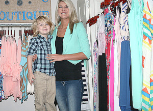 Jordan Traweek and son Maddox in Jordan's new Wild Bleu Boutique on Washington Street in Stephenville. || Photo by BRAD KEITH/TheFlashToday.com