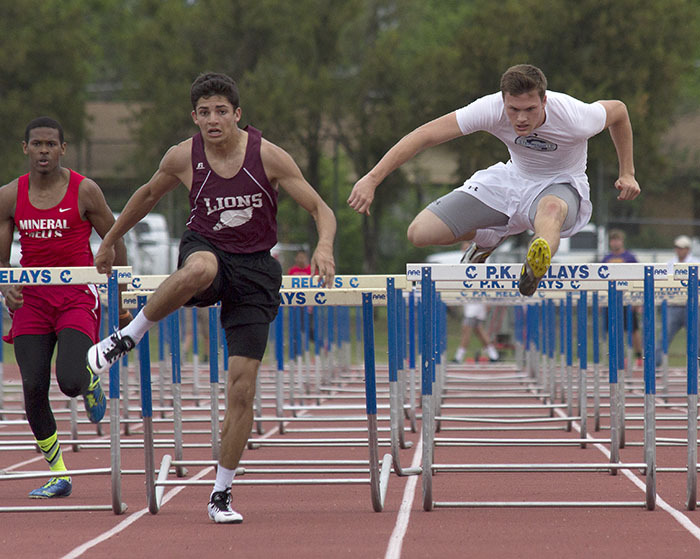 Austin Stufflebean clears the final hurdle and sprints to second in the 110-meter hurdles. || Courtesy Dr. CHET MARTIN